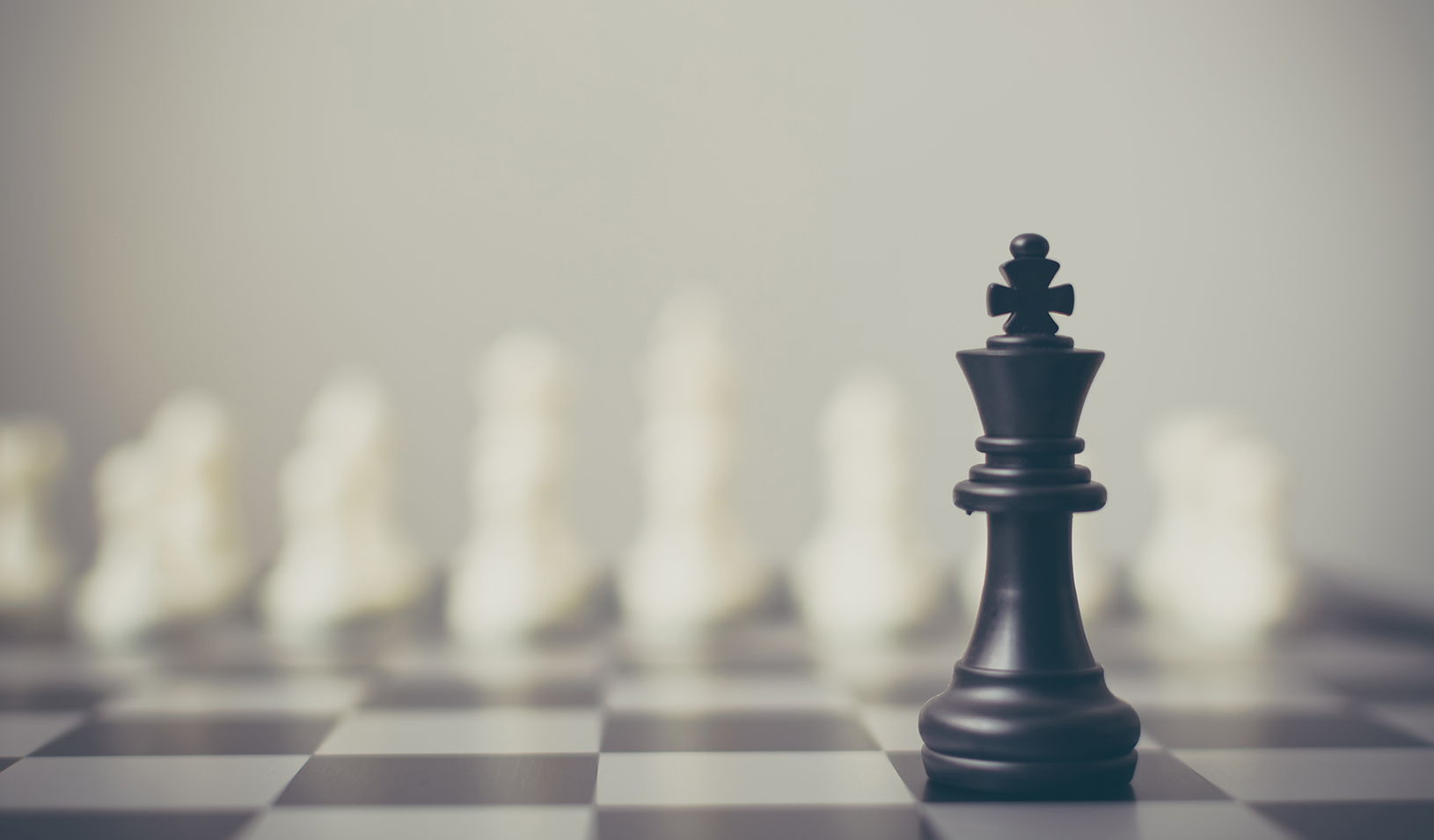 Chess pieces on a board. Credit: iStock/marchmeena29