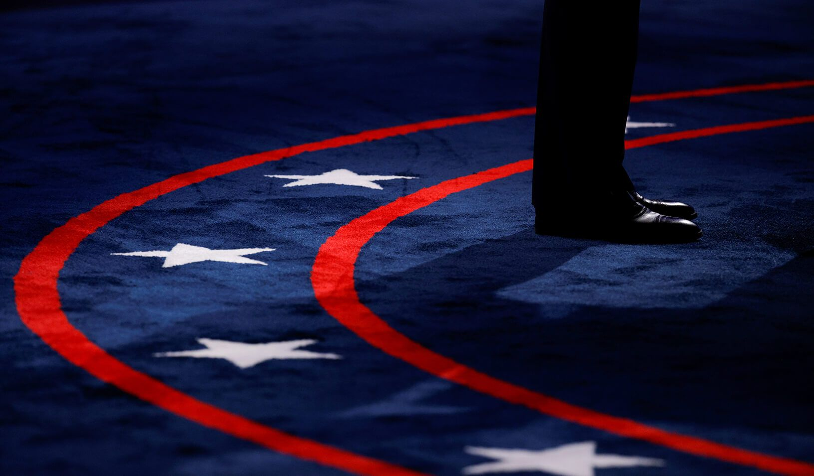 U.S. President Donald Trump stands at his podium as he participates in the first 2020 presidential campaign debate with Democratic presidential nominee Joe Biden. Credit: REUTERS/Brian Snyder