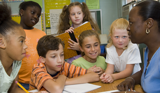 Children in classroom with teacher