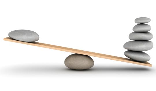 Stones balanced on a plank