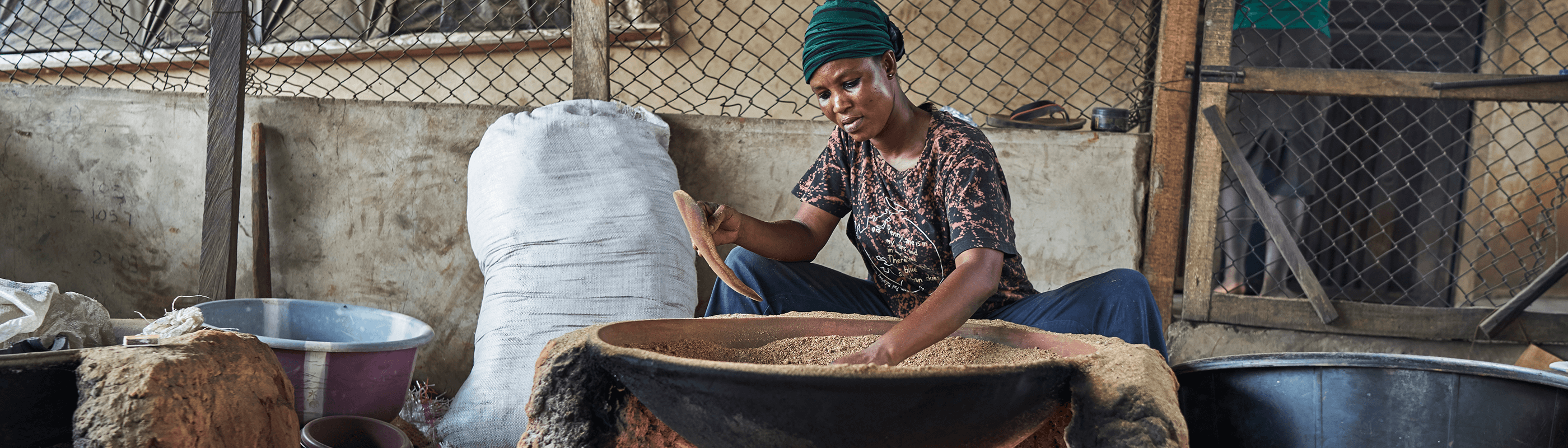 Woman working at Nation Feeders, a Seed company in West Africa.