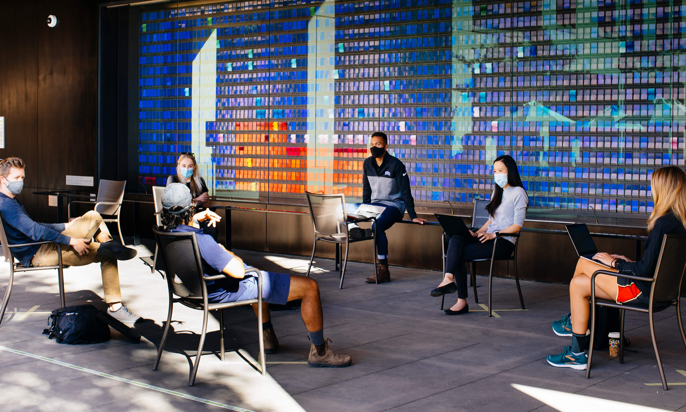 students sitting in front of the Change Wall