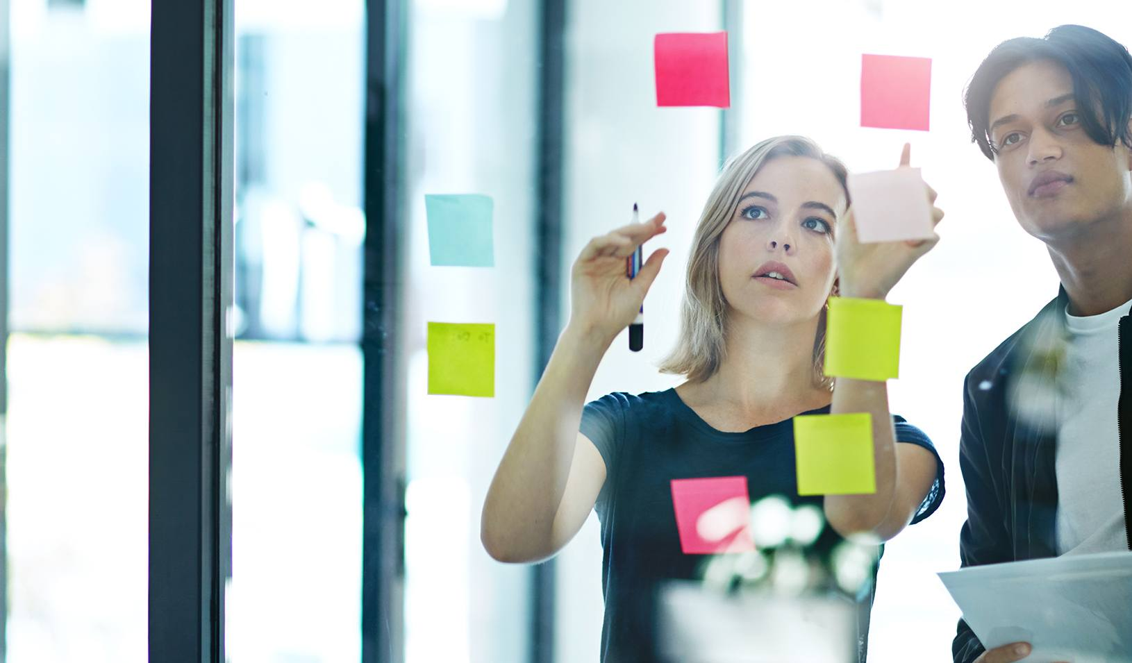 Shot of two colleagues having a brainstorming session in a modern office. Credit: iStock/laflor