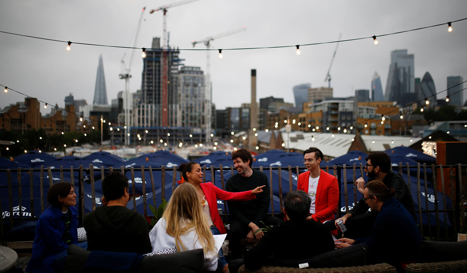 People drink and socialize at the Skylight Bar following the outbreak of the COVID-19 in London. Credit: Reuters/Henry Nicholls