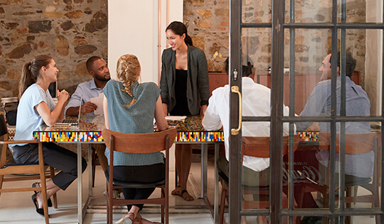 Latina entrepreneur with staff