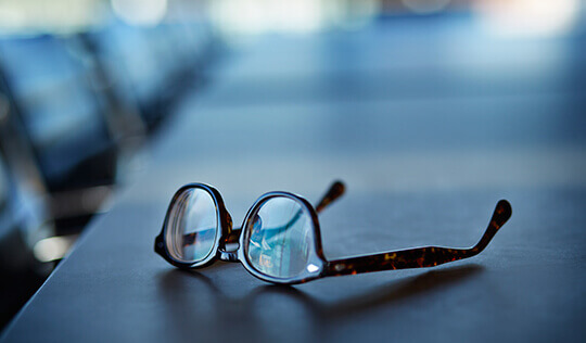 reading glasses on a conference table
