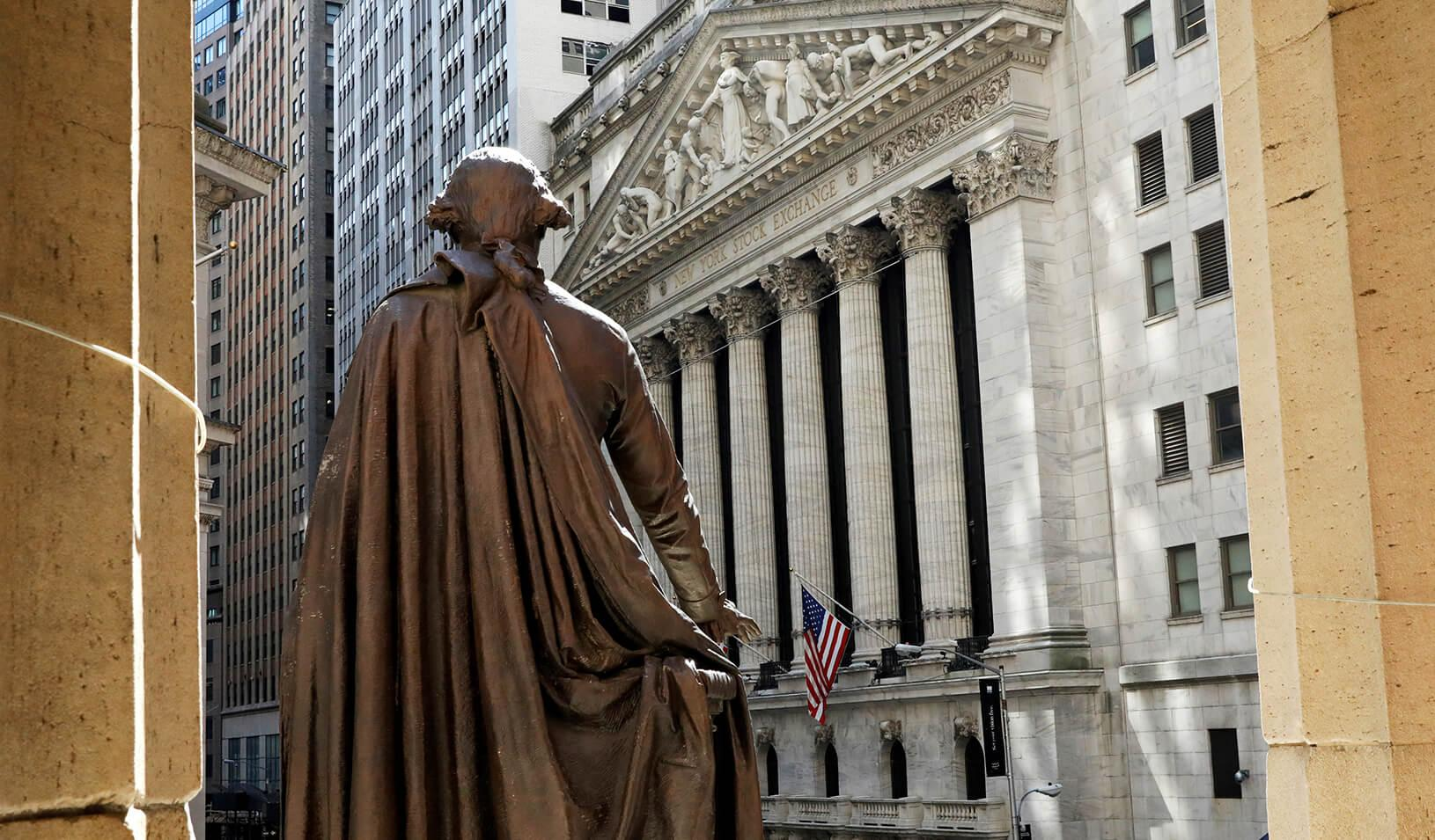 The New York Stock Exchange from the steps of Federal Hall behind a statue of former U.S. President George Washington