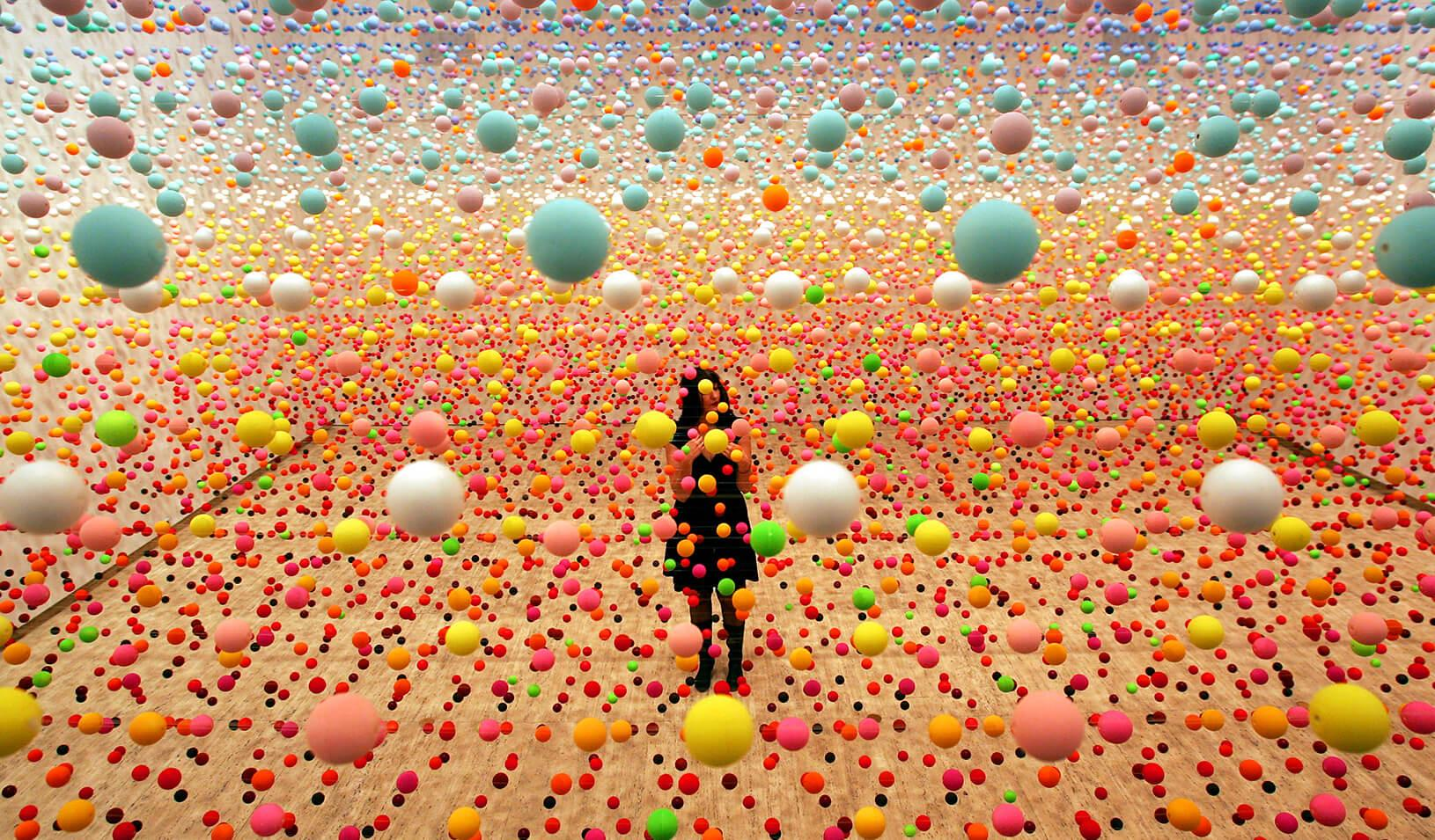 A woman stands in a fleld of dots