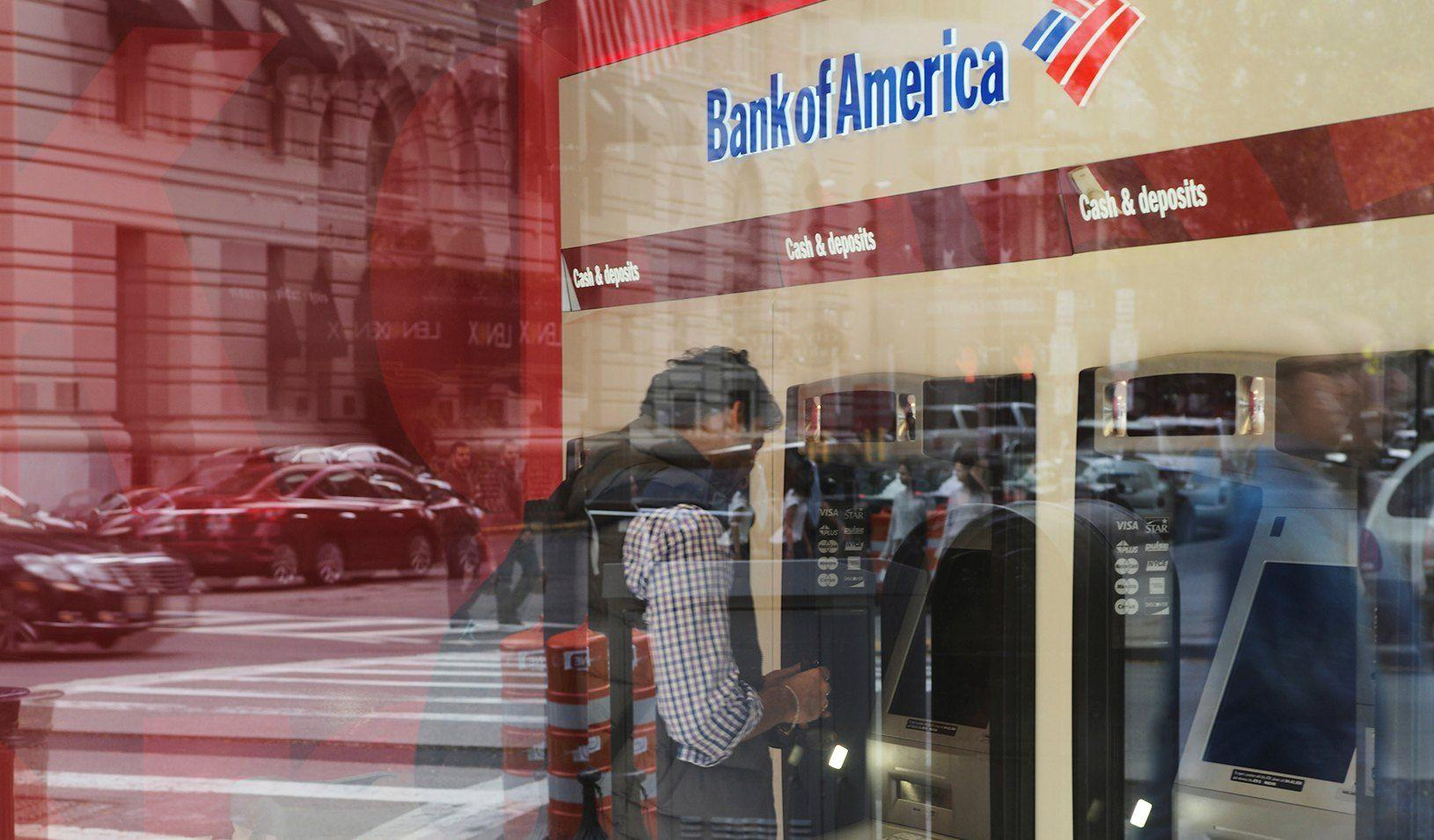 A customer uses an ATM at a Bank of America branch. Credit: REUTERS/Brian Snyder