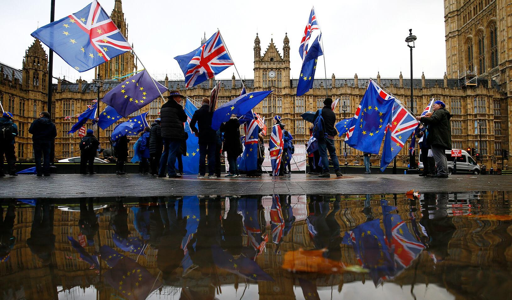 Anti-Brexit demonstrators protest outside the Houses of Parliament in London, Britain. Credit: Reuters/Henry Nicholls