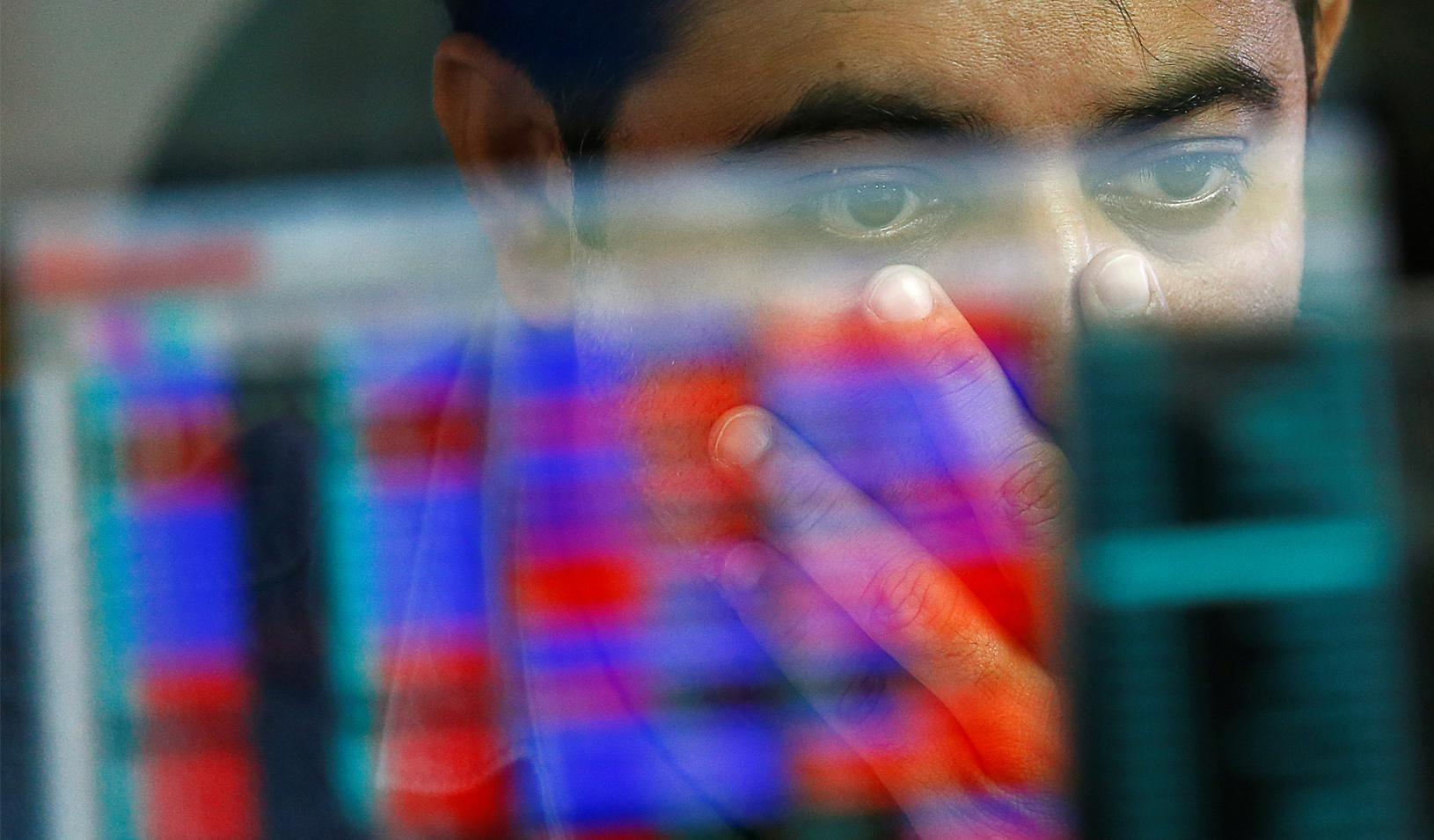 A broker reacts while trading at his computer terminal at a stock brokerage firm in Mumbai, India. Credit: REUTERS/Danish Siddiqui
