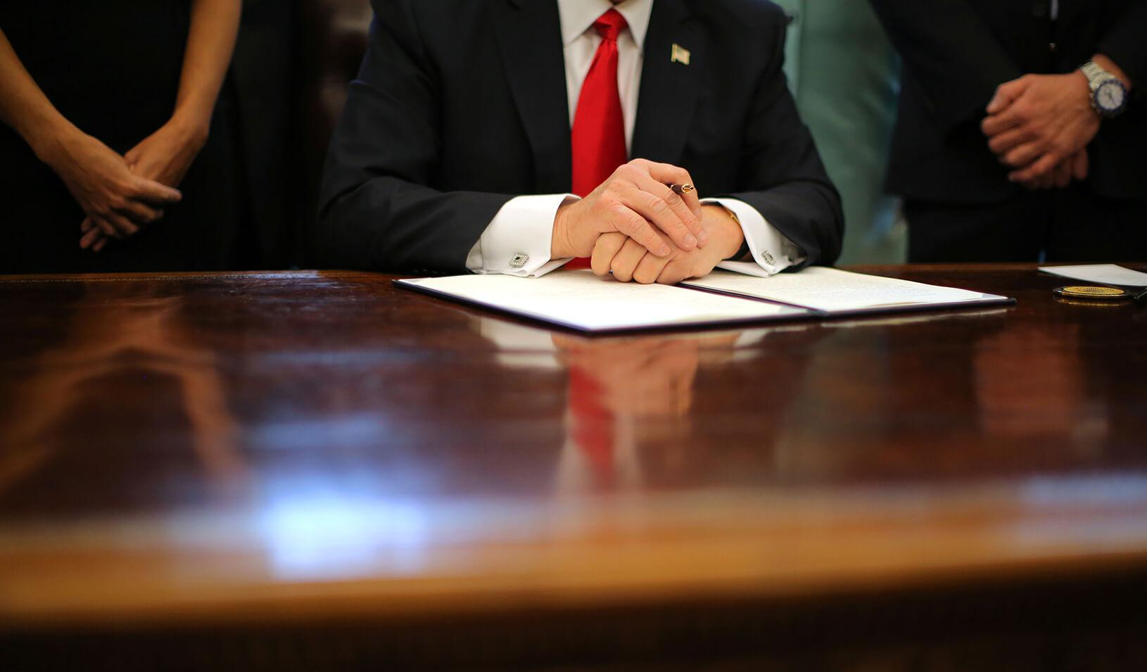 U.S. President Donald Trump at his desk in the Oval Office of the White House. | Reuters/Carlos Barria