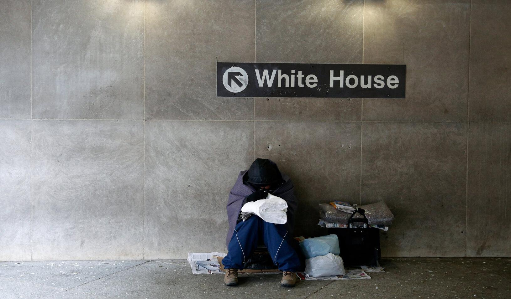 A homeless person tries to stay warm at the entrance of a subway station near the White House. Credit: Reuters/Kevin Lamarque