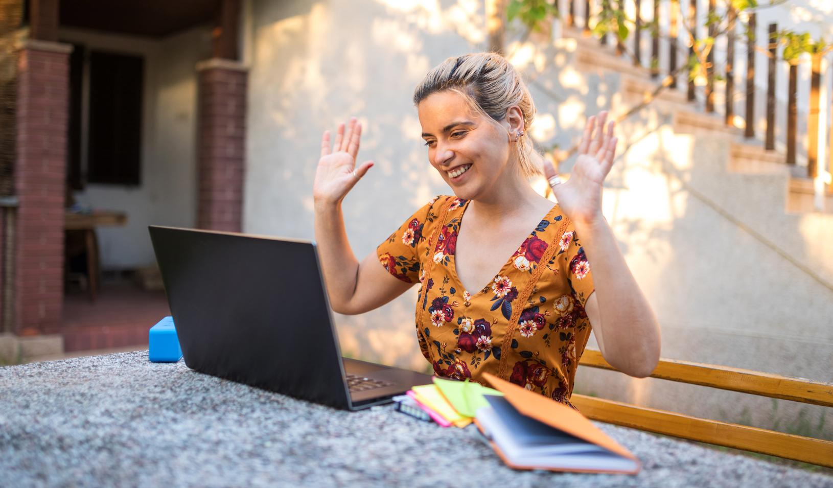A woman giving a presentation online from her home. Credit: iStock/chabybucko