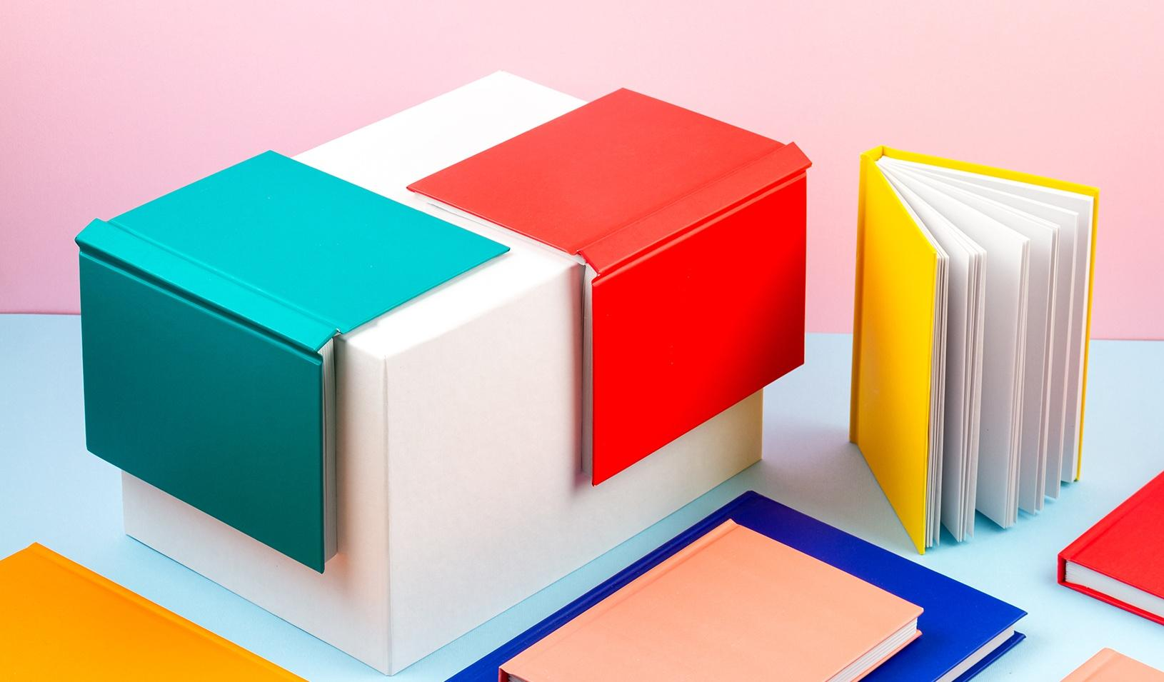An illustration of book covers on a table. Credit: iStock/netrun78