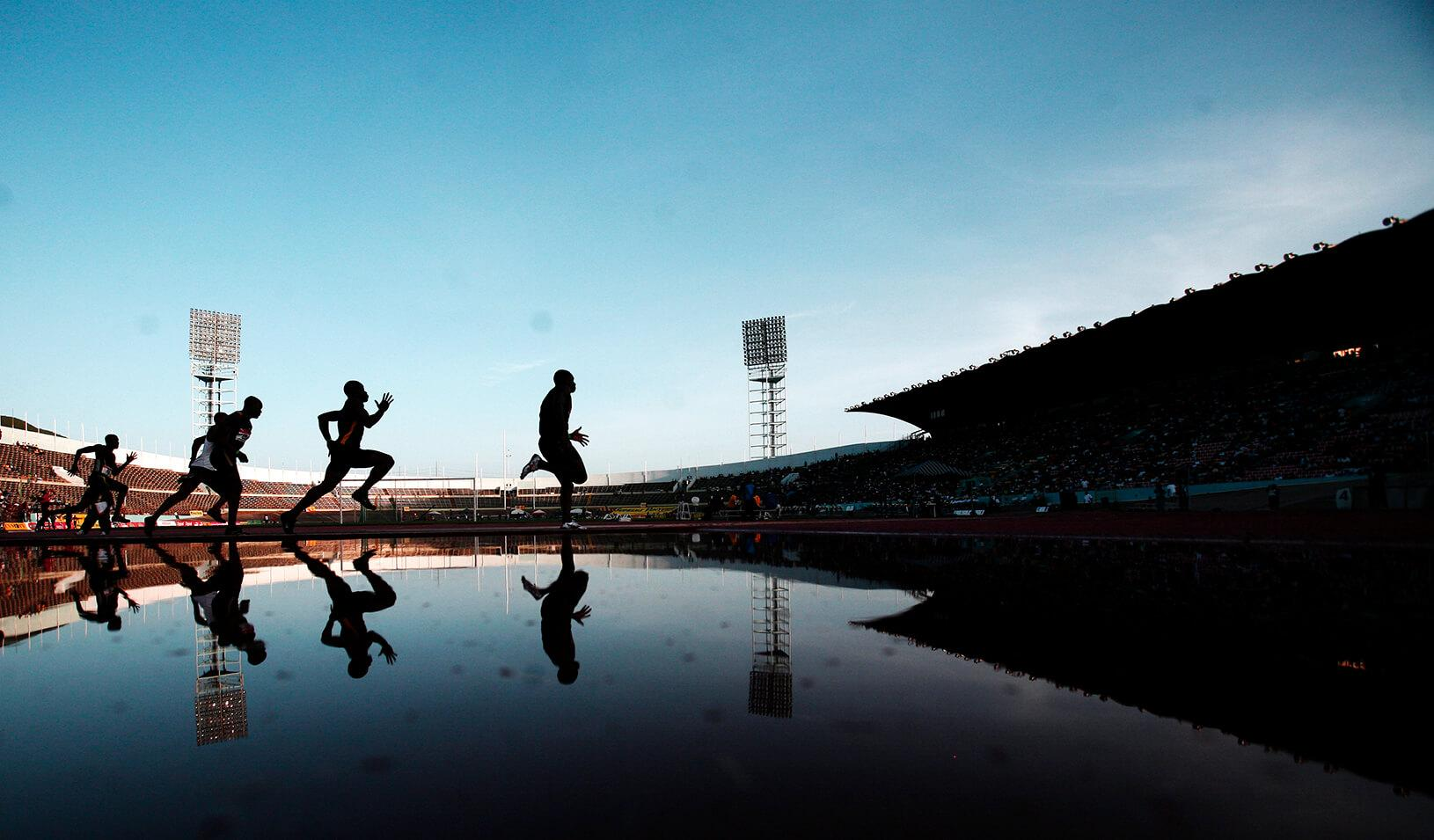 Jamaican athletes compete in the men's 200 meters race.