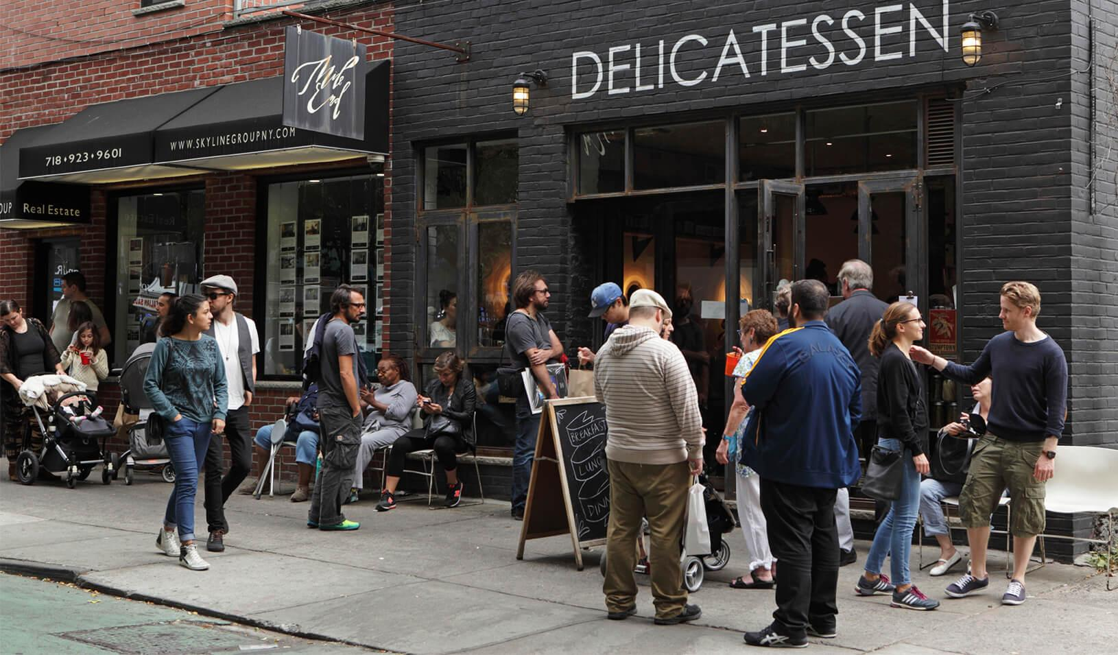 People lined up to buy lunch from Mile End Delicatessen in Brooklyn, New York
