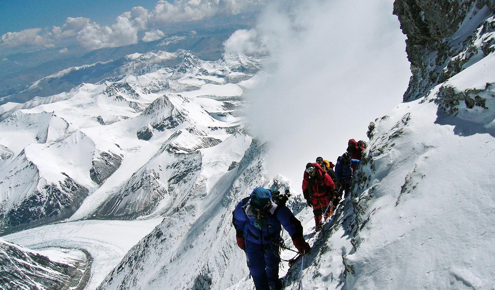 Mountain climbers on a treacherous path