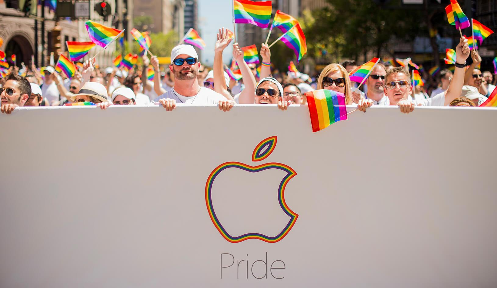 Apple employees carry rainbow flags as they march in the San Francisco Gay Pride Festival. Thousands of Apple employees donned specially designed T-shirts at the festival. Credit: Reuters/Noah Berger