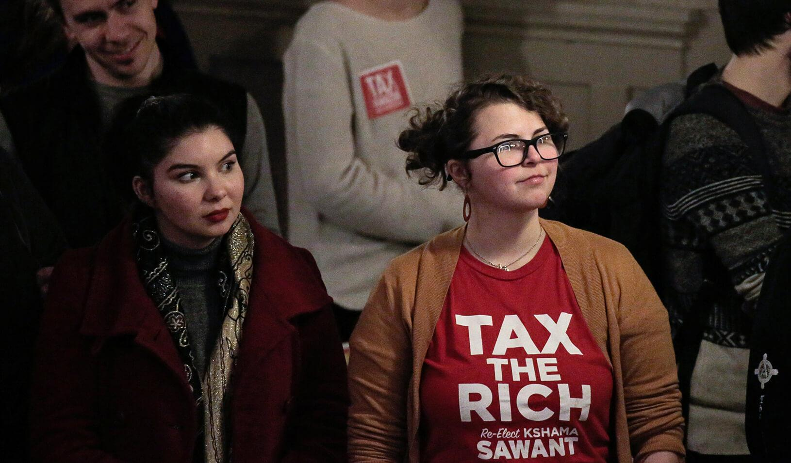 """Supporters listen as Seattle City Councilmember Kshama Sawant restarts the """"Tax Amazon"""" campaign she led in 2019. Credit: REUTERS/David Ryder"""