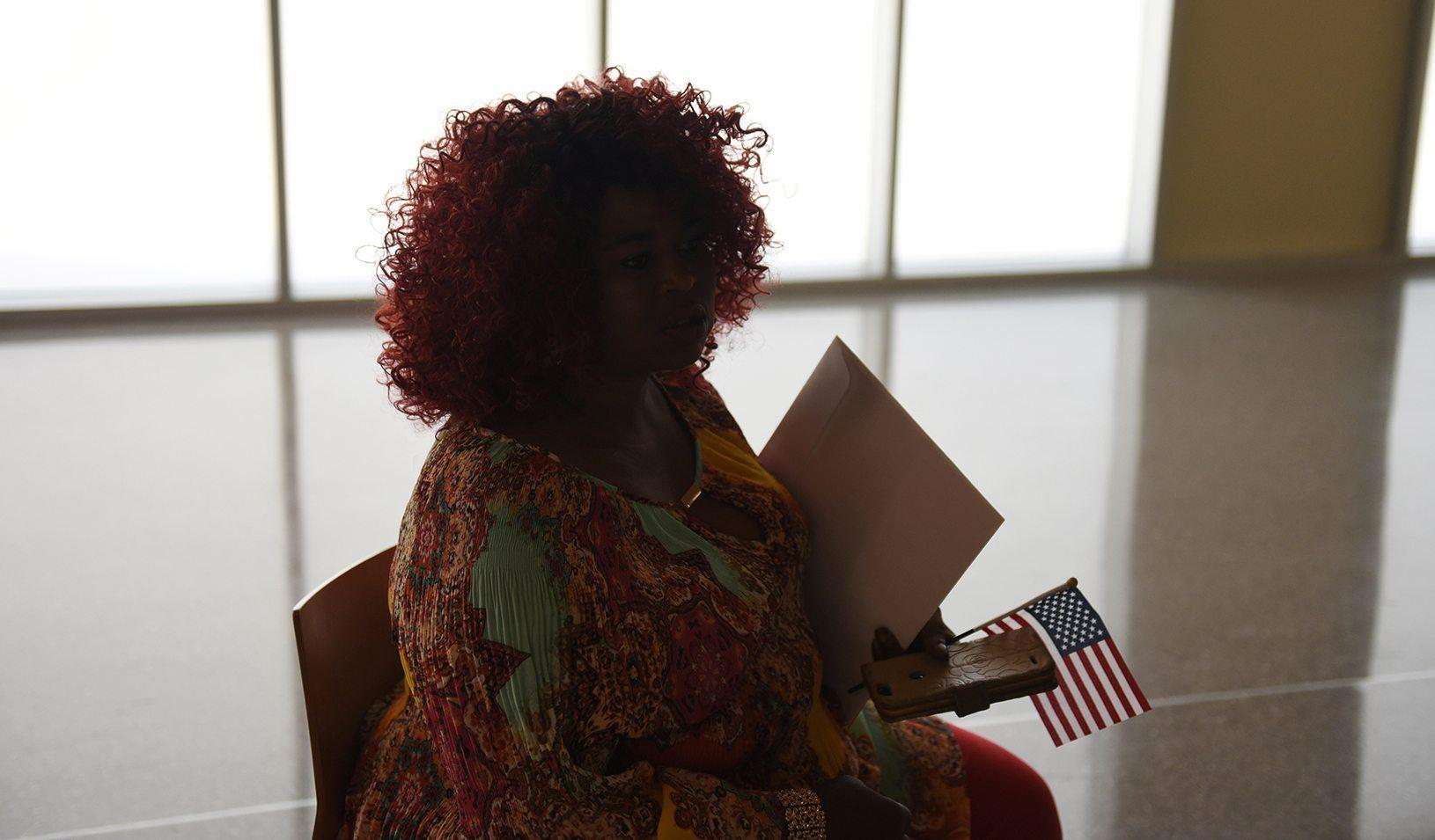 A woman holds an American flag after her daughter's naturalization ceremony in San Antonio, Texas. Reuters/Callaghan O'Hare