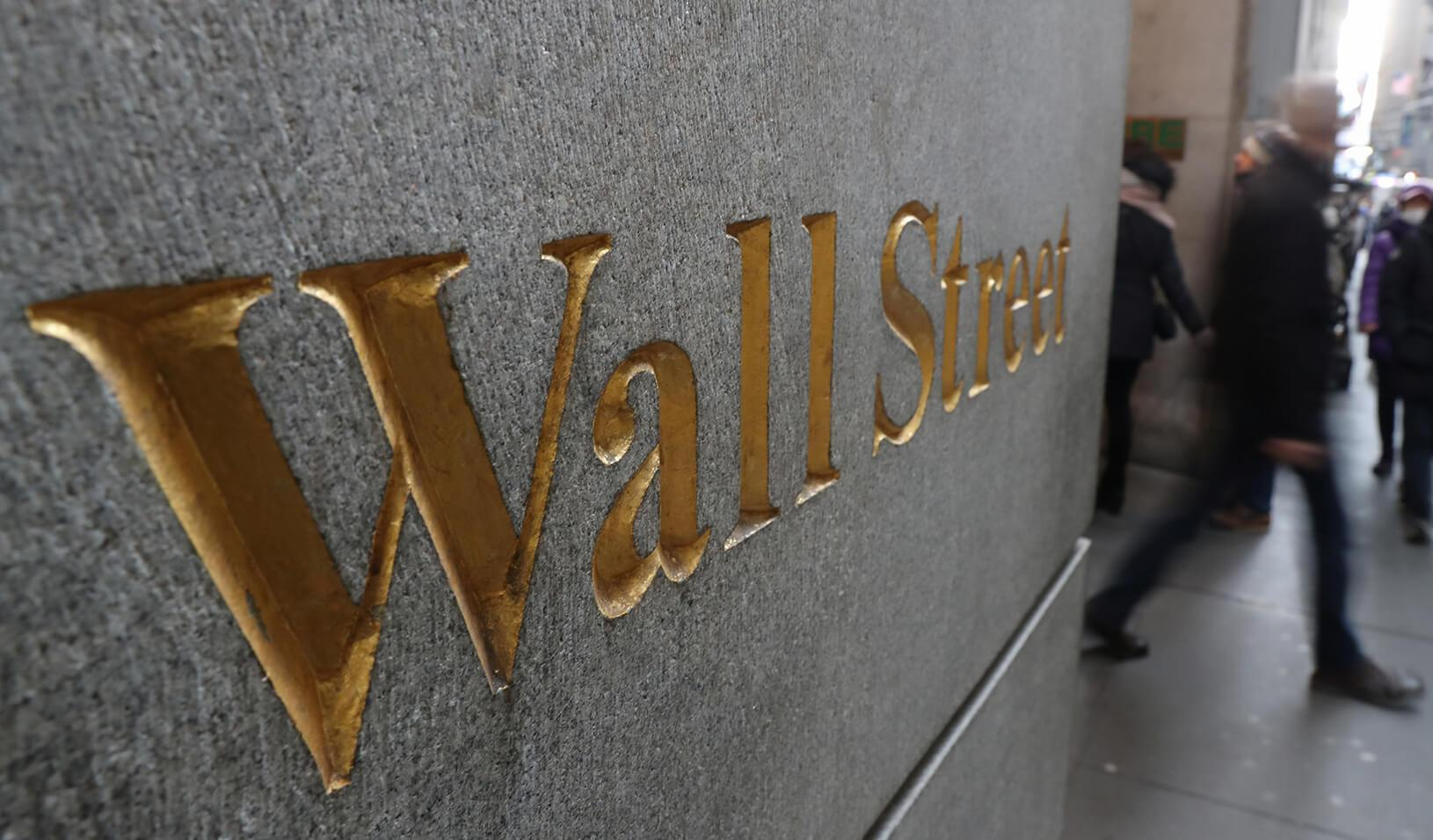 A street sign, Wall Street, is seen outside New York Stock Exchange in New York City. Credit: Reuters/Shannon Stapleton