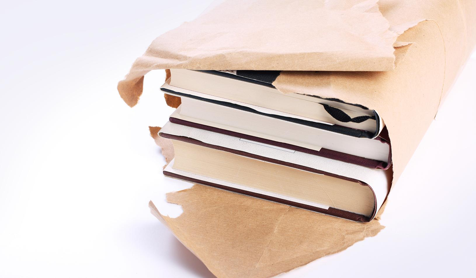 A stack of books being unwrapped. Credit: iStock/Thinglass