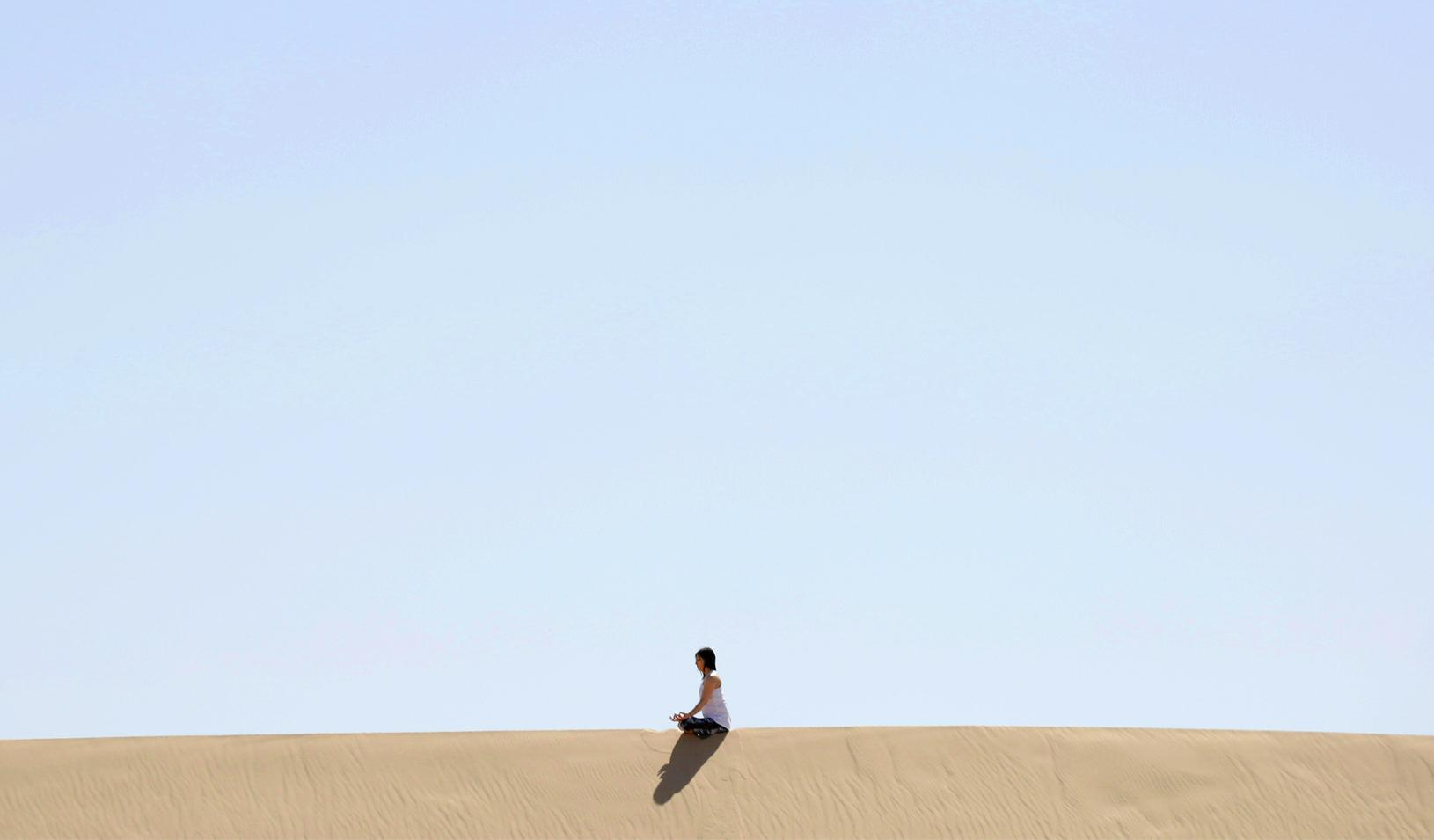 A yoga enthusiast rests after a class at the Samalayuca dunes, on the outskirts of Ciudad Juarez, Mexico. Credit: Reuters/Jose Luis Gonzalez