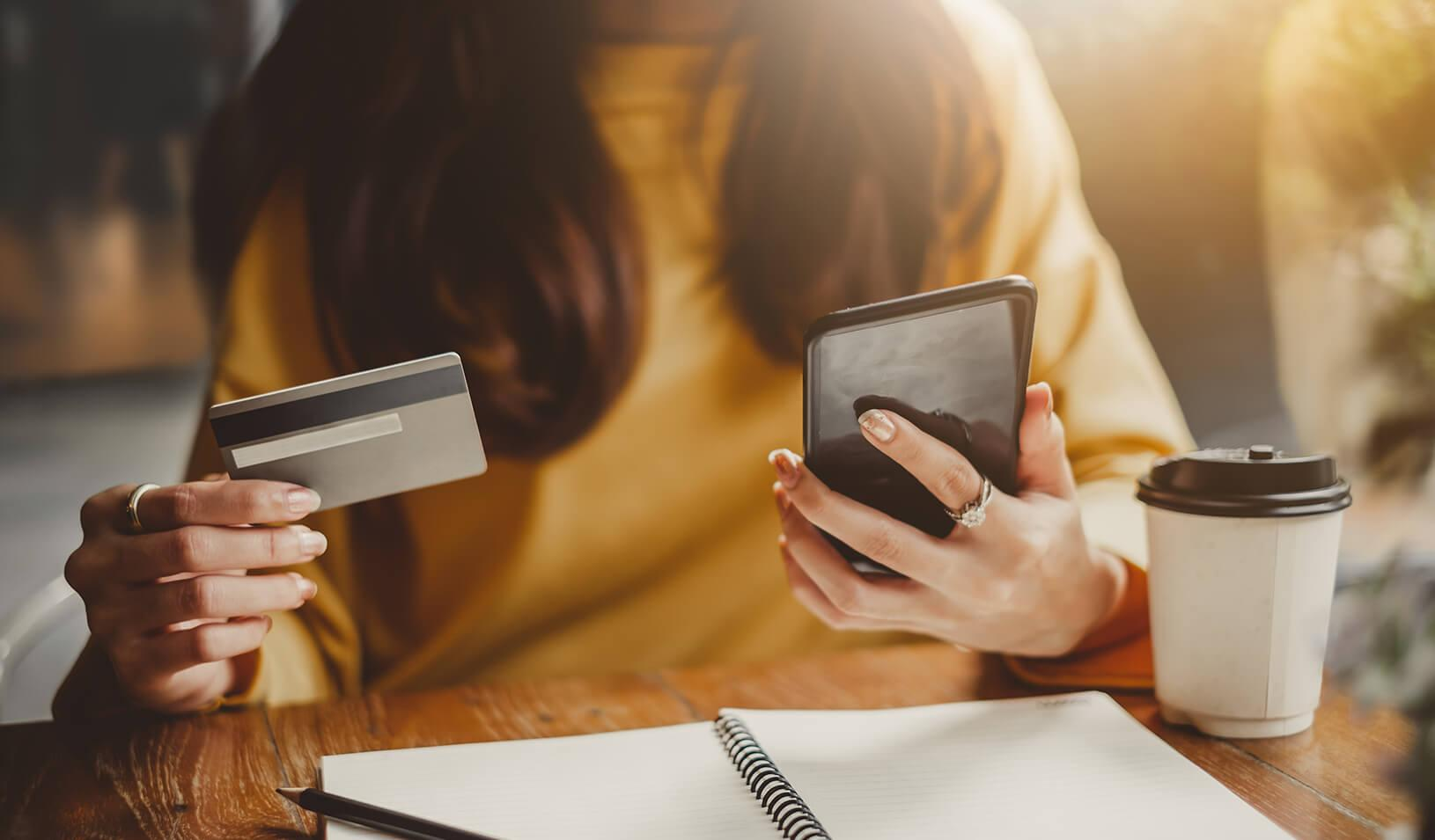 A woman uses her credit card to shop on her smartphone. Credit: iStock/Nattakorn Maneerat