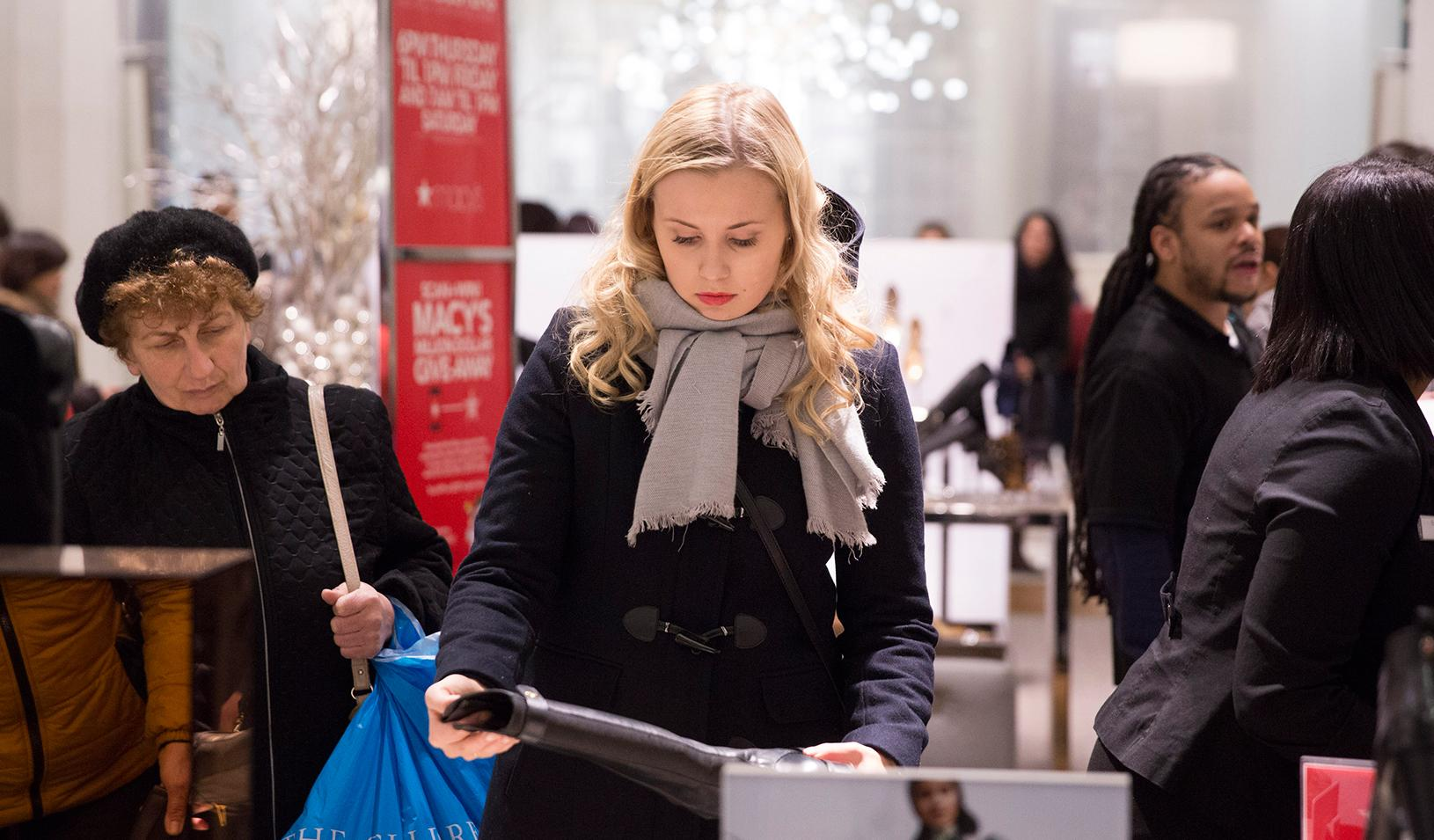 A woman shopping for winter boots