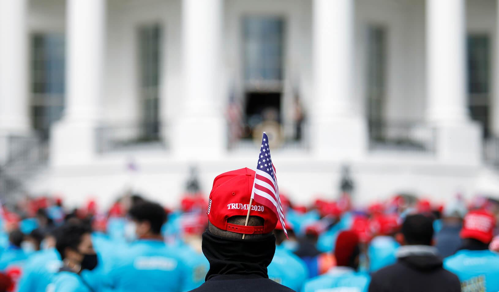 """A supporter of U.S. President Donald Trump waits for the start of the president's campaign rally on the South Lawn of the White House is calling a """"peaceful protest."""" Credit: REUTERS/Tom Brenner"""
