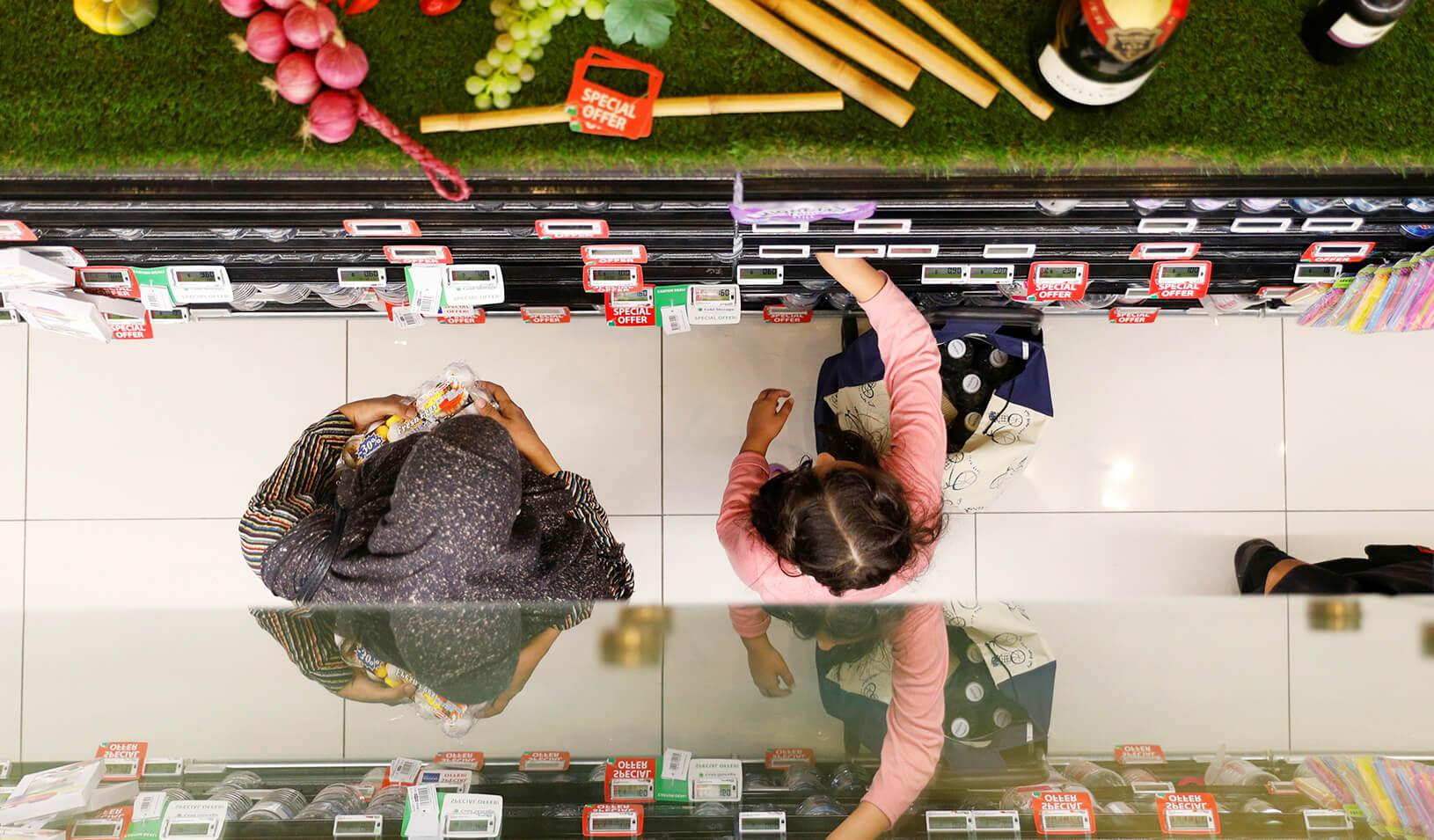 People shop for food at a supermarket | Reuters/Edgar Su