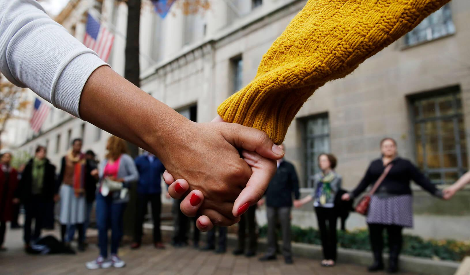A circle of protestors holding hands