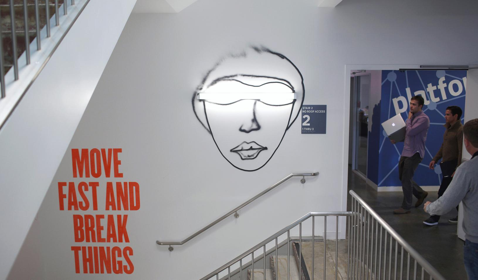 "A message says ""Move Fast and Break Things"" in a Facebook HQ stairwell"