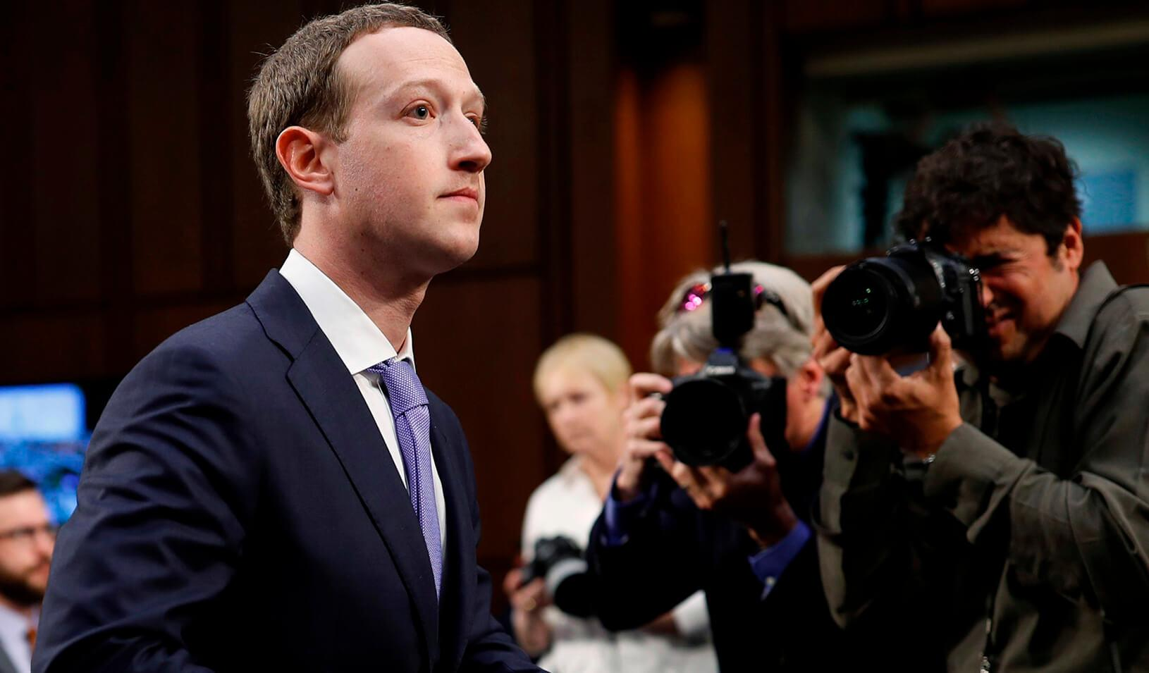 Facebook CEO Mark Zuckerberg stands during a break in testimony before a Senate Judiciary and Commerce Committees joint hearing regarding the company's use and protection of user data. Credit: Reuters/Aaron P. Bernstein