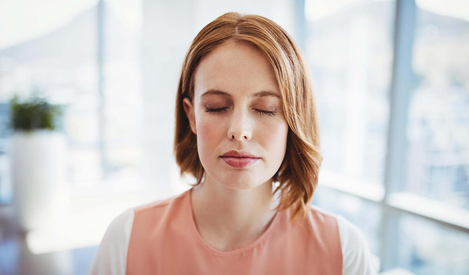 A woman takes a moment to pause and practice mindfulness    iStock/Wavebreakmedia