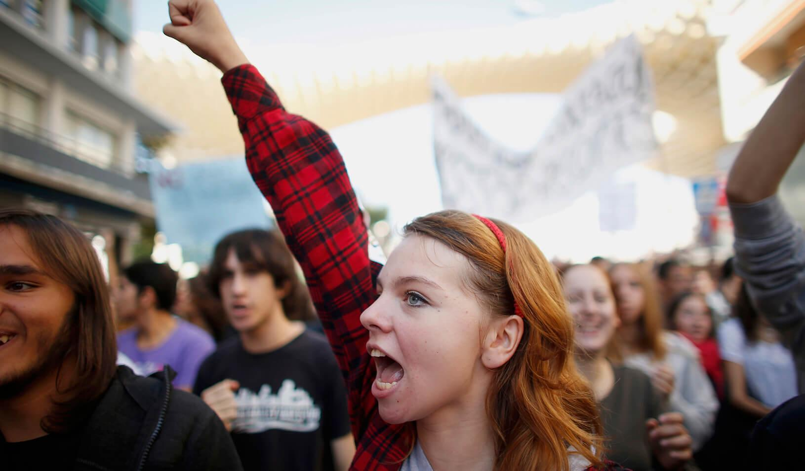A student shouts slogans during a protest