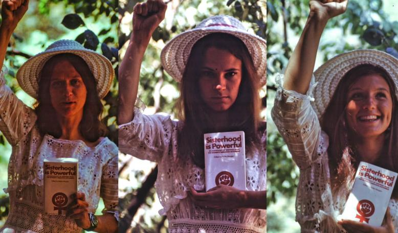 Three women stand with fists raised holding books. Credit: Photo courtesy of Luther Nussbaum