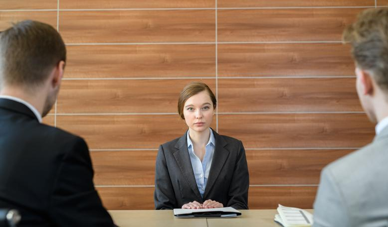 Woman in a business meeting with two men. Credit: iStock/mediaphotos