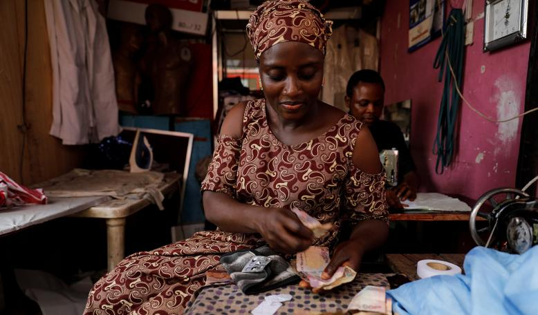 A Nigerian woman sits in a tailoring shop. Credit: Reuters/Akintunde Akinley