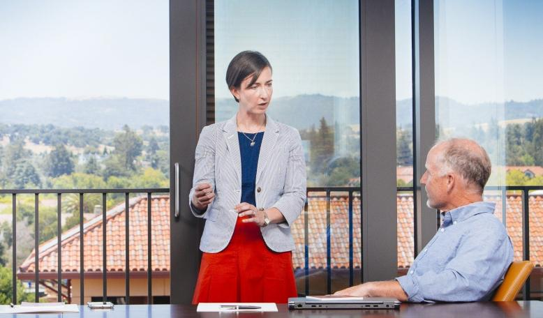 Two people speaking in a board room. Credit: Elena Zhukova