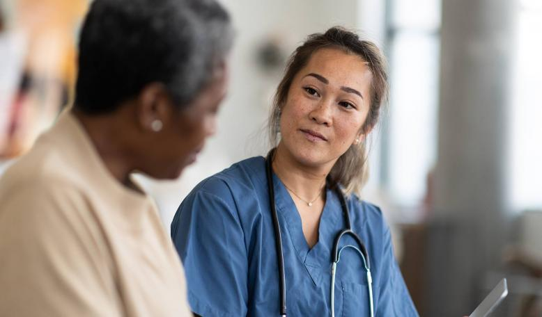 A doctor speaks with her elderly patient. Credit: iStock/FatCamera