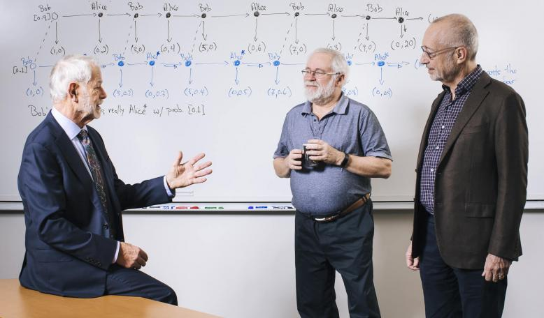 From left, Robert Wilson, David Kreps, and Paul Migrom, received the 2018 John J. Carty Award in the field of economics. | Elena Zhukova