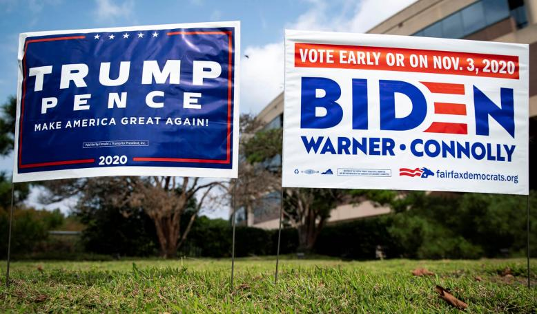 Yard signs supporting U.S. President Donald Trump and Democratic U.S. presidential nominee and former Vice President Joe Biden are seen outside of an early voting site at the Fairfax County Government Center in Fairfax, Virginia. Credit: REUTERS/Al Drago