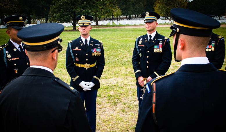 Stanford GSB Alumni Eric Hanft in military uniform, leading a rehearsal before of a large military funeral in Arlington National Cemetery.. Photo Courtesy of Eric Hanft
