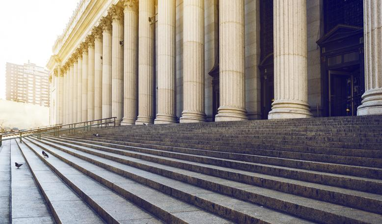 Courthouse steps at dawn. Credit: iStock/ozgurdonmaz