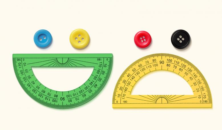 A photo-illustration of protractors and buttons arranged to look like a happy face and a sad face. Credit: Alvaro Dominguez