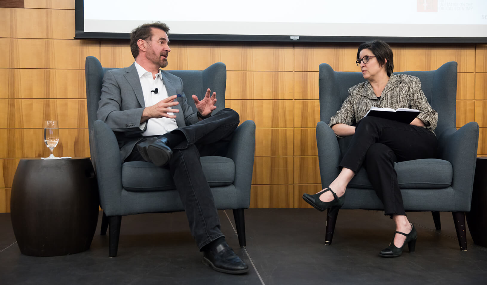 HAI Distinguished Fellow Erik Brynjolfsson and Stanford GSB Professor Susan Athey discuss the ethics of AI at a recent conference, Credit: Holly Hernandez