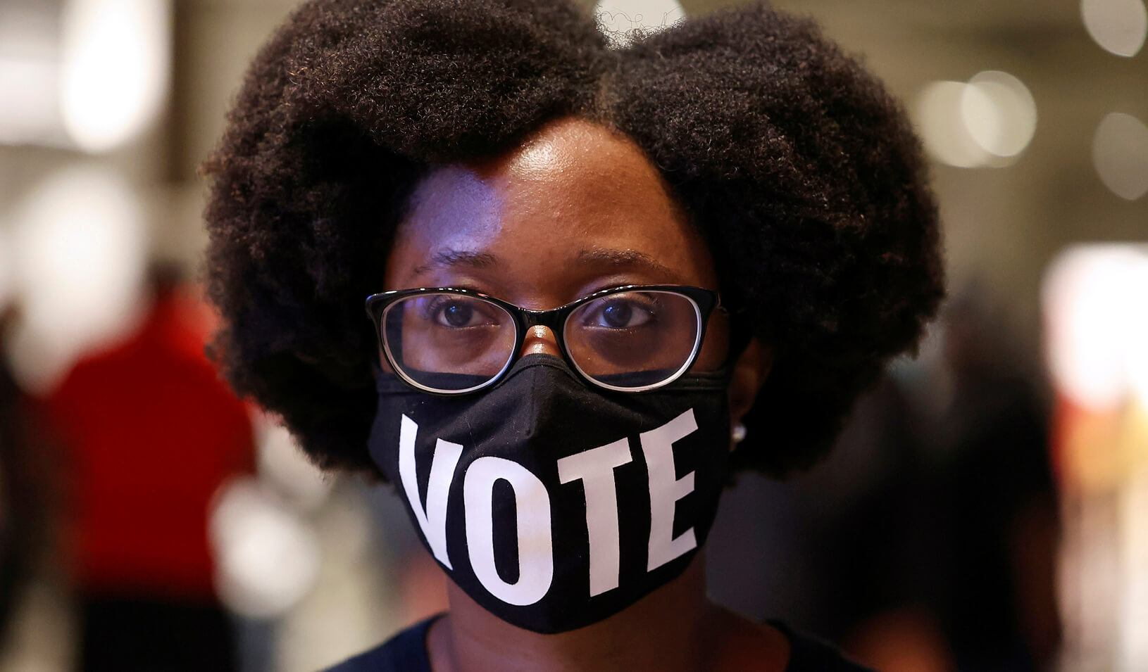 Ashley Nealy waits in line to cast her ballot during early voting for the upcoming presidential elections in Atlanta, Georgia, U.S., October 12, 2020. Credit: REUTERS/Chris Aluka Berry