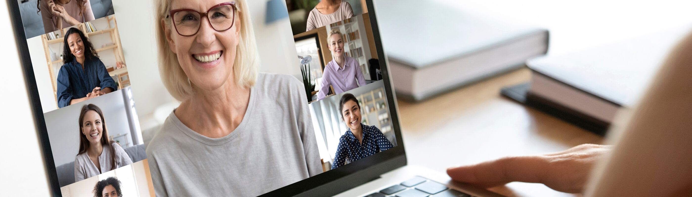 A group of women on a video conference call on a laptop